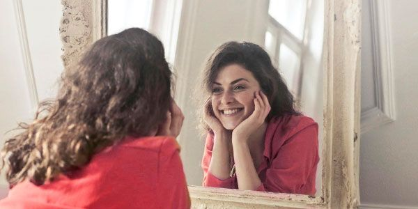 smiling on mirror